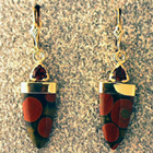 dangle earrings with trillion-cut pyrope garnets and tongue-shaped jasper.
