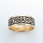 "14 karat yellow gold ""bendy"" knot celtic band with rails."