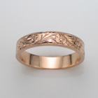 14 karat rose gold flat band with spanish-style hand-engraved pattern.
