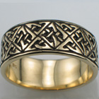 "14 karat yellow gold band with ""triangles and squares"" celtic pattern."