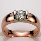 14 Karat Rose gold two-tone saddle ring with 0.63 carat round brilliant diamond in platinum saddle.