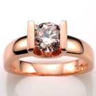 "14 Karat Rose gold saddle ring with 1.34 ct. ""top-light-pink"" natural color diamond."