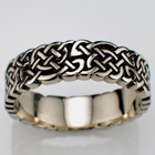 "14 Karat white gold celtic ""no-rails pretzel"" knot band."