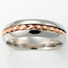 Palladium band with 14 Karat Rose gold twisted wire inlay.