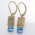 princess-cut natural blue zircon dangles with multi-colored textured 14 karat gold plates.