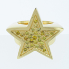Gold star ring with yellow diamonds.