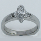 Ploatinum diamond ring with a marquise-cut center stone and trilliant sides.