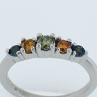 Platinum diamond ring with natural green center diamond and natural orange diamonds and natural color-changing Alexanderites.