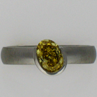 Brushed Platinum band with oval-shaped natural fancy intense canary-yellow diamond in diagonally-oriented half-bezel.