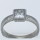 Hand-engraved Palladium diamond ring with princess-cut diamond in full engraved bezel on knife-edge style shank.