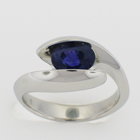 Platinum ring with Color-changing Sapphire in swoopy freeform yin-yang setting.