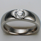 Platinum ring with flush-set round brilliant diamond.