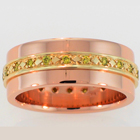 14 karat Rose gold flat band with yellow diamonds bead-set in 18 karat yellow gold inlay.