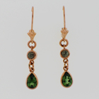 14 karat6 rose gold dangle earrings with round green diamonds and pear shaped green tourmalines.