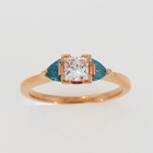14 karat rose gold ring with a princess-cut diamond and two blue diamond trilliants
