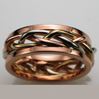 14 karat tri-colored braid band with 14karat rose gold rails.
