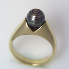 yellow gold ring with rippled black pearl