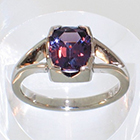 Palladium split-shank ring with cushion-shaped purple Spinell in 4-way semi-bezel