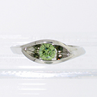 Platinum wrap-around v-shaped channel ring with channel-set iradiated green round brilliant diamond