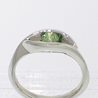 Platinum wrap-around v-shaped channel ring with channel-set iradiated green round brilliant diamond (alternate view)