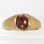 14 Karat Yellow gold hammered ring with lens-cut Matrix Diamond in polished bezel