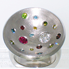 Palladium multi-colored dish ring with flush-set irradiated diamonds in a variety of sizes and colors