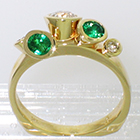"14 Karat Yellow Gold multi-bezels ring with Emeralds and Diamonds set all ""willy-nilly"" in conical bezels"