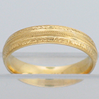 14 Karat Yellow Gold band with triple-millgrain and hand-engraved e-h pattern borders