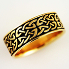 14 karat yellow gold celtic band with oval-shaped double-bendy knots.
