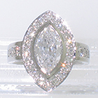 "Platinum ""Halo"" ring with Marquise-shaped diamond surrounded by bead-set melee round diamonds with bead-set round melee diamonds on cathedral shank (alternate view)"