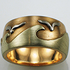 14 karat multi-colored gold band with ocean theme in brushed finish.