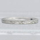 Palladium flat band with hand-engraved flowers and vines pattern