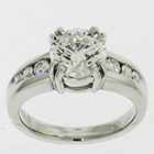 Platinum ring with 3 ct round brilliant diamond in 8-prong gallery setting on tapered channel shank