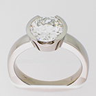 Palladium solitaire ring with 2 ct round brilliant diamond in semi-bezel setting on heavy round shank