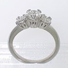 "Platinum 3-stone ring with round diamonds in ""empire"" style 8-prong settings"