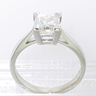 Platinum solitaire ring with princess-cut square diamond in 4-prong setting on cathedral shank