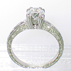 "Platinum hand-engraved solitaire with 0.80 carat round brilliant diamond in 8-prong fancy ""fishtail"" style setting"