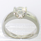 Platinum solitaire ring with 0.72 ct round brilliant diamond channel-set into oversized saddle setting