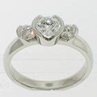Platinum 3-stone ring with round brilliant diamonds in semi-bezel settings