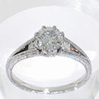"Platinum hand-engraved Split-Shank ring with 0.52 carat round brilliant diamond in fancy 8-prong ""crown"" style setting with channel-set round brilliant melee diamonds in shank"