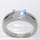 Platinum matte-finished solitaire with princess-cut diamond in angular saddle setting over open channel