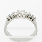 Flat Platinum band with baguette and princess-cut diamonds channel-set between flat rails