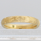 14 Karat Yellow Gold hand-engraved band with woven pattern