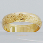 14 Karat Yellow Gold hand-engraved band with acorns and oak leaves pattern