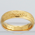 "14 Karat Yellow Gold hand-engraved band with ""wriggles"" pattern"