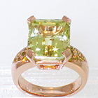 14 Karat Rose gold ring with 8 carat rectangular chrysoberyl in 4-prong setting and round natural yellow melee diamonds bead-set in shank
