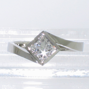 Platinum solitaire with princess-cut diamond in diagonally-oriented full bezel