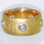 22 Karat Yellow Gold Band with Natural finish and rose-cut round diamonds set in low-profile Platinum bezel settings