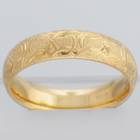 14 Karat Yellow Gold hand-engraved band with celtic infinity pattern