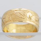 14 Karat Yellow Gold wide band with hand-engraved hawaiian floral design